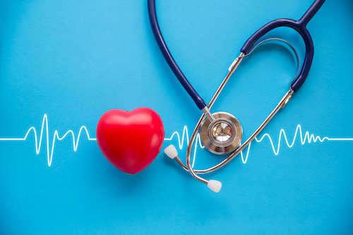 heart and stethoscope on blue background with echocardiogram
