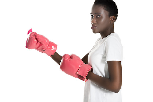 black woman with pink boxing gloves