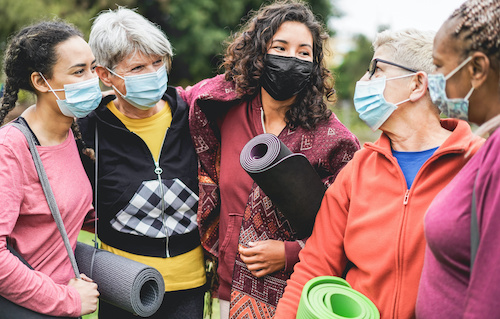 group of multicultural women in exercise clothes and masks