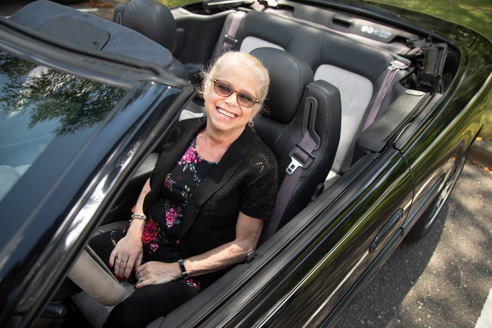 Ruth Hansen sitting in a convertible