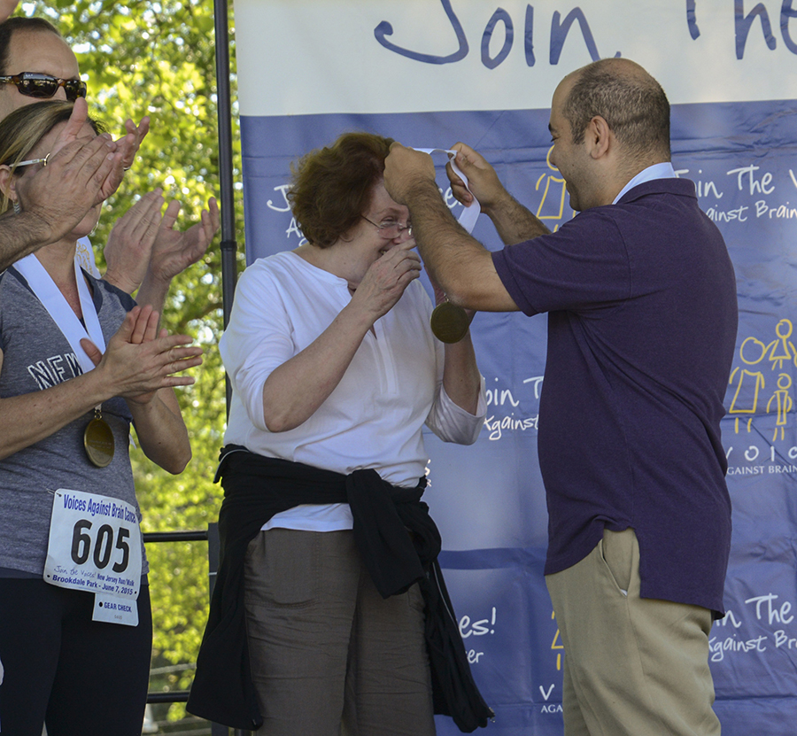 Simon Hanft, MD awards the medal to Catherine Furnbach, RN