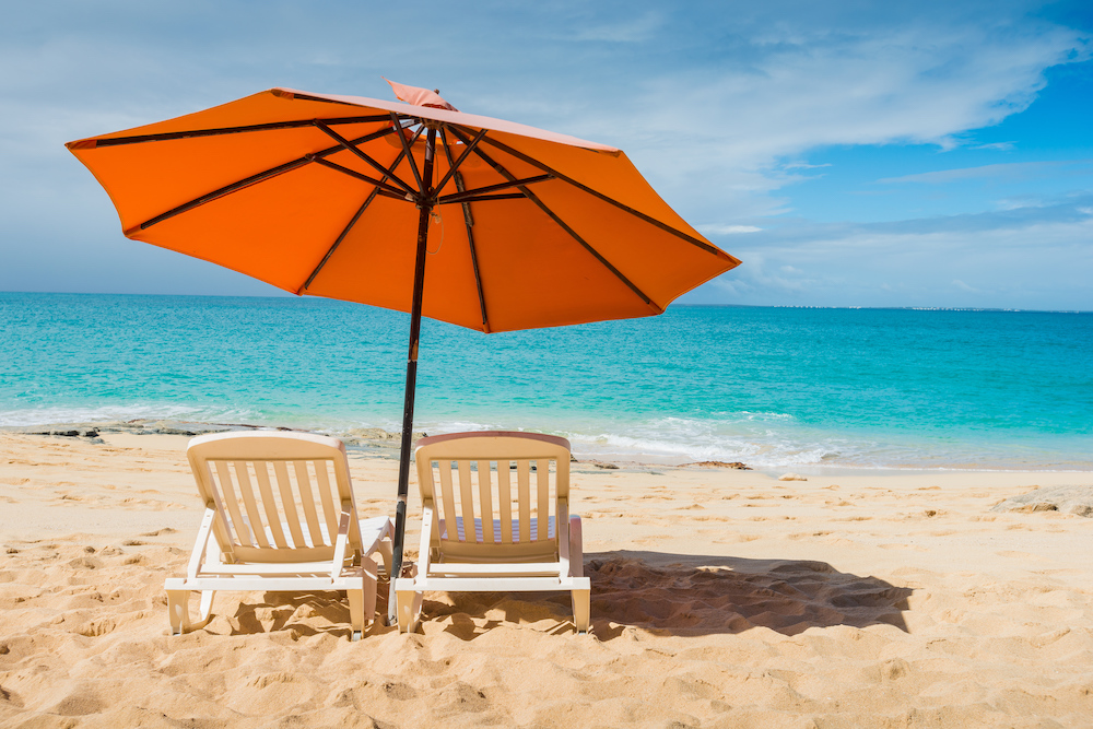 image of two chairs and umbrella on a beach